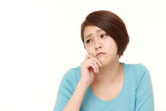 Young Japanese woman worries about something Royalty Free Stock Image