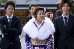 Young Japanese women kimono men suits temple Stock Photos