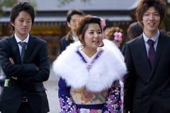 Young Japanese women kimono men suits temple. Young Japanese woman in kimono on Coming of Age Day (seijin no hi). The Coming of Age ceremony (seijin shiki in Stock Photos