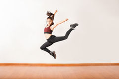 Young jazz dancer jumping in a studio Stock Image