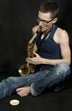 Young jazzman plays a saxophone Royalty Free Stock Photography
