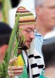 Young Jew with citrus-etrog praying in Sukkot Royalty Free Stock Image