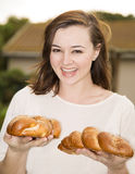Young Jewish woman holding two challah loaves Stock Photo