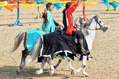 Young knights horseback riding on purebred horses royalty free stock image
