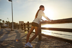 Young jogger exercising on the coastline Royalty Free Stock Image