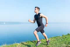 Young jogger running in morning Athlete runner working out cardio. Royalty Free Stock Photos