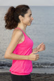 Young jogger woman jogging on beach Royalty Free Stock Image