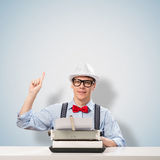 Young journalist. Image of a young journalist, sitting at the table for a typewriter Royalty Free Stock Photography