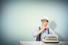 Young journalist. Image of a young journalist, sitting at the table for a typewriter Royalty Free Stock Photos