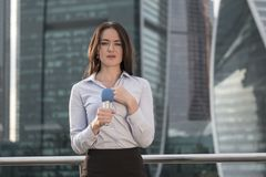 Journalist is reporting on a business center background. Young journalist is reporting on a business center background Royalty Free Stock Images
