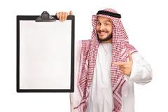 Young joyful Arab holding a clipboard Stock Photos