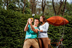 Young and joyful couple having fun and photographing with old ph Royalty Free Stock Photo