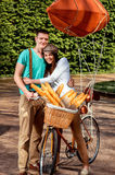 Young and joyful couple hugging in the park with bicycle and air Royalty Free Stock Photography