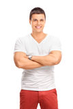 Young joyful man in a plain white t-shirt. Vertical shot of a young joyful man in a plain white t-shirt looking at the camera and smiling isolated on white royalty free stock images