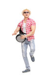 Young joyful man playing on a doumbek and dancing Royalty Free Stock Photo