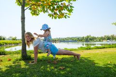 Young joyful mother with small daughter having fun royalty free stock photography
