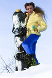 Young joyful snowboarder woman at mountains Royalty Free Stock Photography