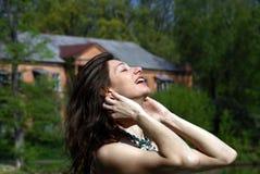 Young joyful woman. On nature background Royalty Free Stock Photos