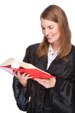 Young judge. Full isolated studio picture from a young judge (lawyer) with statute book Stock Image