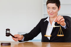 Young judge with a gavel and the justice scale Stock Image