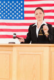 Young judge knocking a gavel Stock Image