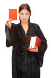 Young judge with red card. Full isolated studio picture from a young judge (lawyer) with red card Stock Photo