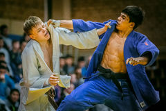 Young judoists during fight hold each other for kimono Stock Photo