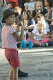Young juggler. Young player while playing with a spinning top in a street show Royalty Free Stock Photo