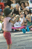 Young juggler. Young player while playing with a spinning top in a street show Stock Photography
