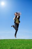 The young jumping girl with headphones Royalty Free Stock Photography