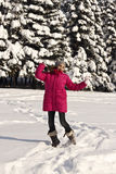 Young jumping girl in snowy winter Stock Photography