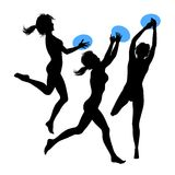 Young jumping girls, silhouette. Young jumping girls with blue frisbee disk, silhouette Royalty Free Stock Images
