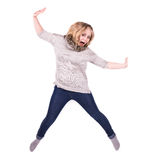 Young jumping woman. Young woman jumping with arms out and look happy Royalty Free Stock Photo