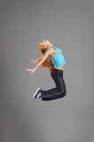 Young jumping woman Stock Images