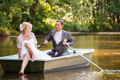 Young just married bride and groom on boat Stock Photo