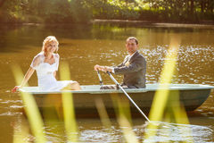 Young just married bride and groom on boat Stock Image