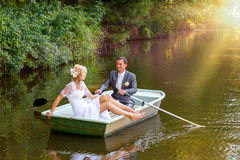 Young just married bride and groom on boat Royalty Free Stock Photos