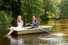 Young just married bride and groom on boat Stock Photos