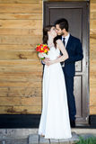 Young just married couple in front of the door Stock Photo