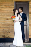 Young just married couple in front of the door Stock Images