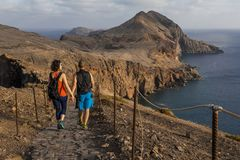 Young, just married couple is hiking by the tourist`s trail. stock photography