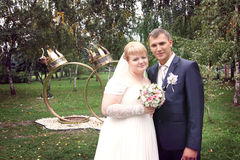 Young just married couple in park Stock Image