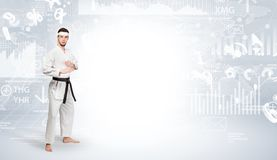 Karate man doing karate tricks on the top of a metropolitan city. Young karate trainer doing karate tricks on the top of a metropolitan cityn royalty free stock image