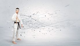 Karate man doing karate tricks with chaotic concept Stock Image