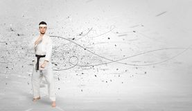 Karate man doing karate tricks with chaotic concept. Young karate trainer doing karate tricks with chaotic conceptn royalty free stock image