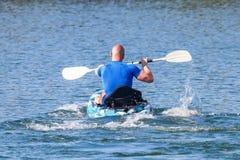 Young Kayaker Paddling Kayak. Sportsman kayaking Blue Water. Outdoor Sport stock images