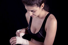Young kickboxer rolls up the bandage Royalty Free Stock Photos