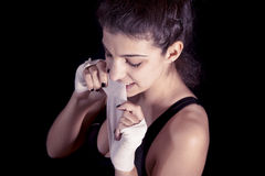 Young kickboxer rolls up the bandage Royalty Free Stock Images