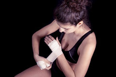 Young kickboxer rolls up the bandage Stock Images