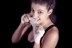 Young kickboxer rolls up the bandage Royalty Free Stock Image